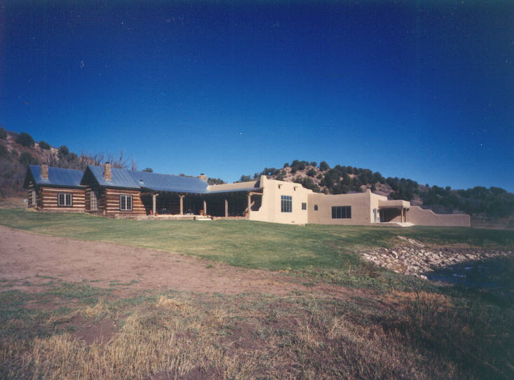 Hearthstone log and timber frame homes custom adobe and for Adobe style modular homes