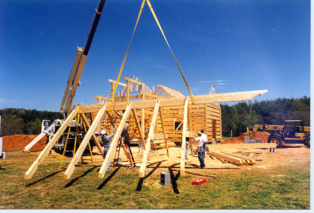 Collar ties are attached to rafter sets and entire assembly is lifted.